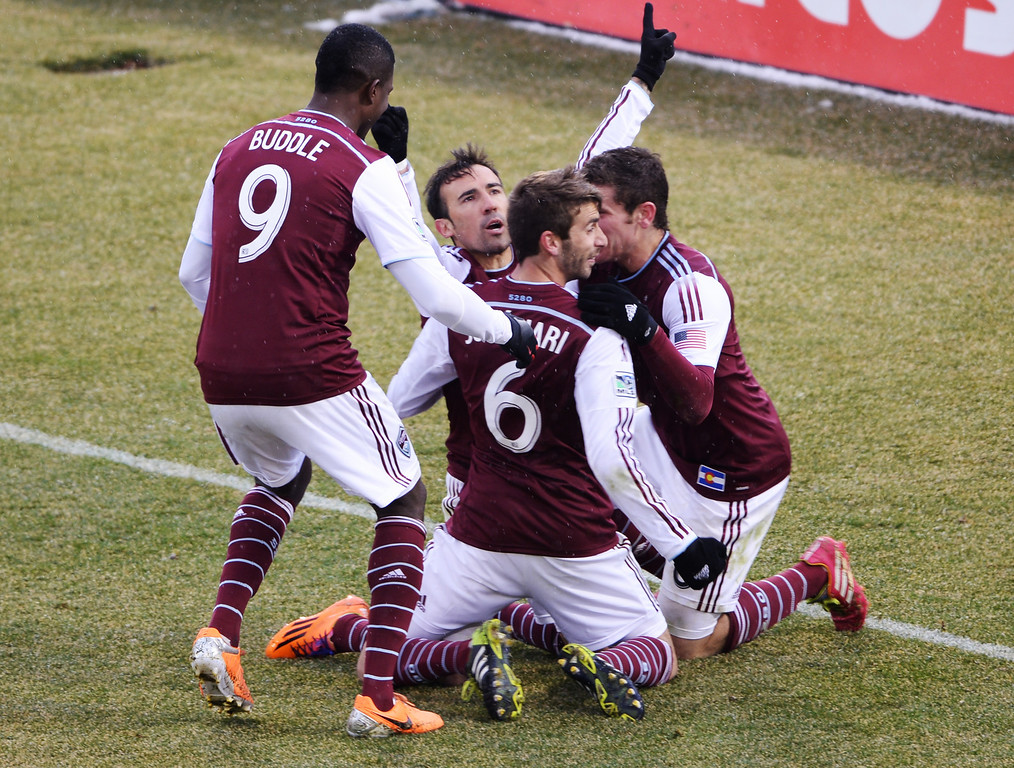 . COMMERCE CITY MARCH 22: Colorado Rapids\' Edson Buddle (9), Jose Mari (6), Vincente Sanchez (facing camera) and Dillon Posers (8) celebrate Sanchez\'s goal in the second half of an MLS soccer game against the Portland Timbers in Commerce City, Colo., Saturday, March 22. 2014. Colorado won 2-0. (Photo by Hyoung Chang/The Denver Post)