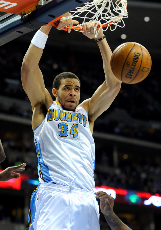 . DENVER, CO. - MARCH 22: JaVale McGee (34) of the Denver Nuggets slammed two points through the hoop in the first half. The Denver Nuggets hosted the Sacramento Kings Saturday night, March 23, 2013 at the Pepsi Center. (Photo By Karl Gehring/The Denver Post)