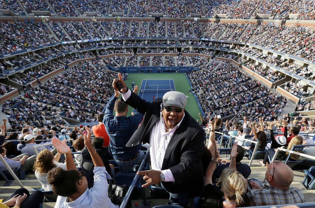 . A spectator cheers during play between Rafael Nadal, of Spain, and Novak Djokovic, of Serbia, during the men\'s singles final of the 2013 U.S. Open tennis tournament, Monday, Sept. 9, 2013, in New York. (AP Photo/Julio Cortez)