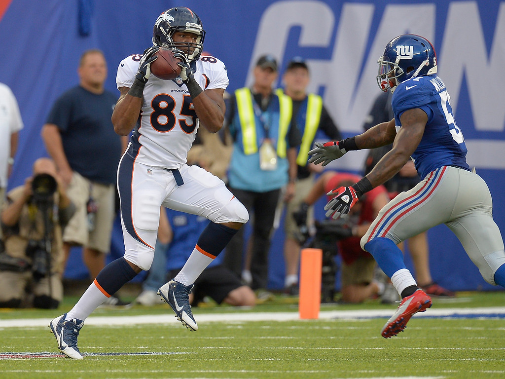 . Denver Broncos tight end Virgil Green (85) catches a pass for a short gain as New York Giants outside linebacker Jacquian Williams (57) moves in on defense during the third quarter September 15, 2013 MetLife Stadium. (Photo by John Leyba/The Denver Post)