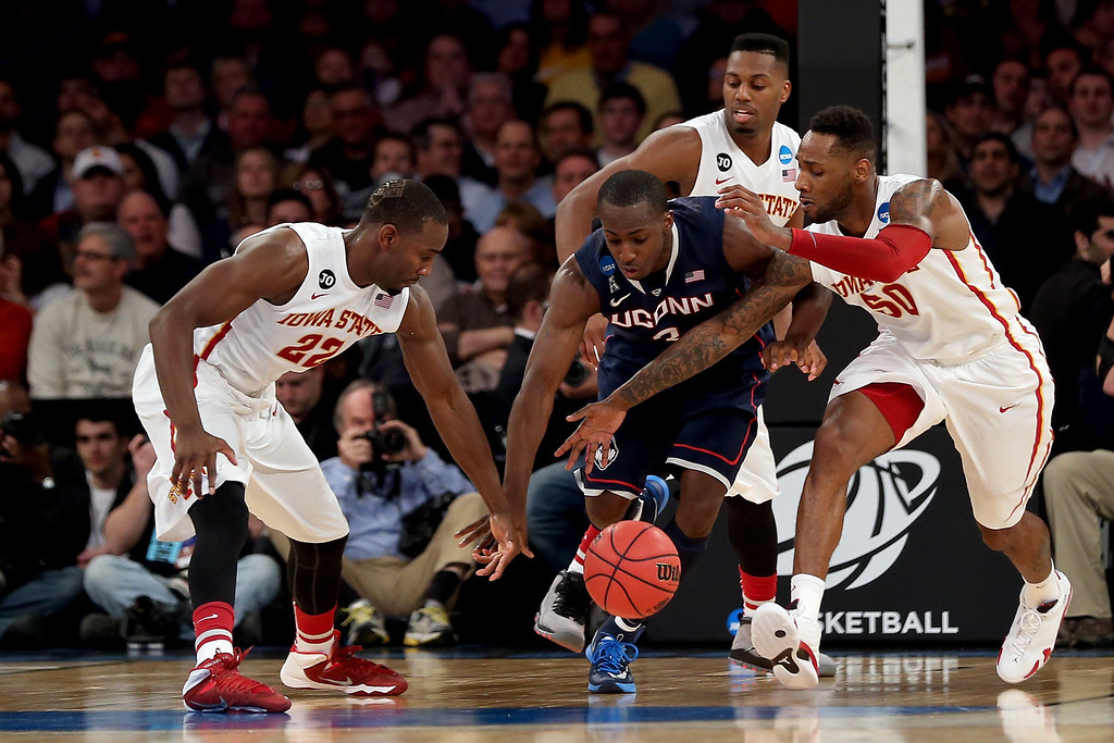 . DeAndre Daniels #2 of the Connecticut Huskies fights for the ball against Dustin Hogue #22 and DeAndre Kane #50 of the Iowa State Cyclones during the regional semifinal of the 2014 NCAA Men\'s Basketball Tournament at Madison Square Garden on March 28, 2014 in New York City.  (Photo by Bruce Bennett/Getty Images)