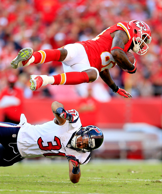 . Wide receiver Dwayne Bowe #82 of the Kansas City Chiefs is upended by free safety Shiloh Keo #31 of the Houston Texans after making a catch during the 1st half of the game at Arrowhead Stadium on October 20, 2013 in Kansas City, Missouri.  (Photo by Jamie Squire/Getty Images)