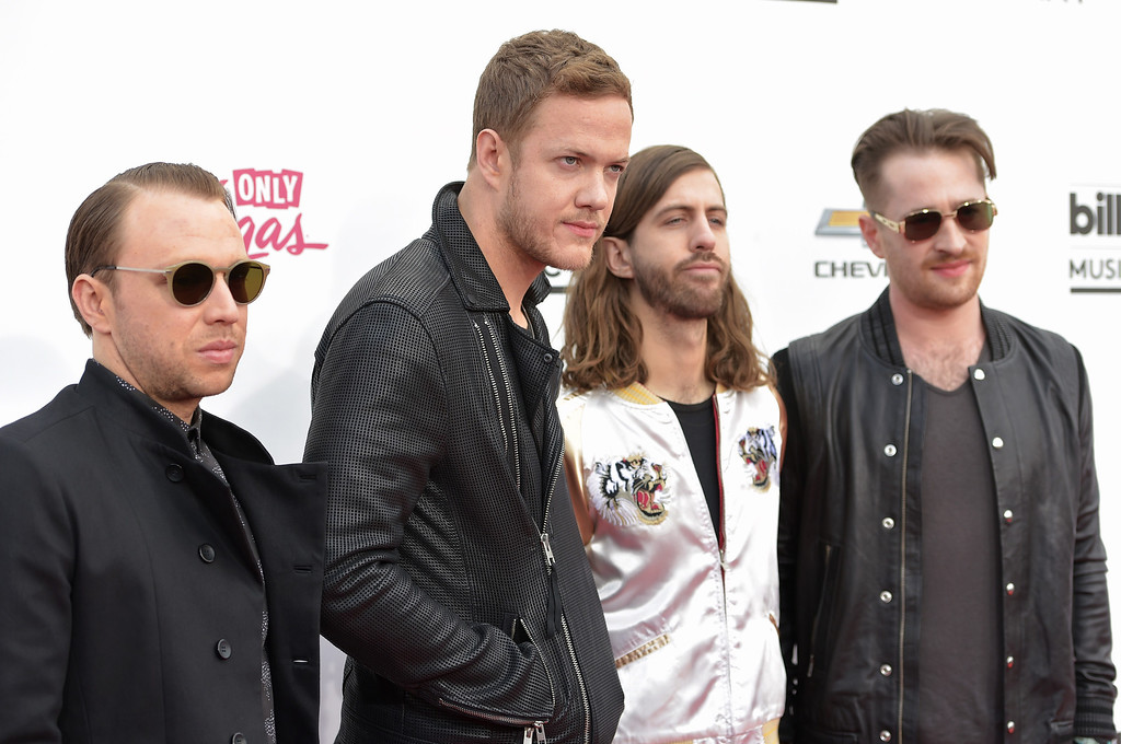 . Ben McKee, from left, Dan Reynolds, Wayne Sermon and Daniel Platzman, of the musical group Imagine Dragons, arrive at the Billboard Music Awards at the MGM Grand Garden Arena on Sunday, May 18, 2014, in Las Vegas. (Photo by John Shearer/Invision/AP)