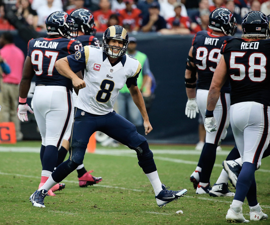 . Sam Bradford #8 of the St. Louis Rams celebrates a third quarter touchdown pass against the Houston Texans at Reliant Stadium on October 13, 2013 in Houston, Texas.  (Photo by Scott Halleran/Getty Images)