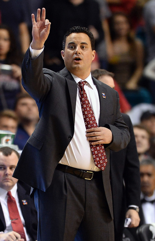 . LAS VEGAS, NV - MARCH 14:  Head coach Sean Miller of the Arizona Wildcats signals his players during a semifinal game of the Pac-12 Basketball Tournament against the Colorado Buffaloes at the MGM Grand Garden Arena on March 14, 2014 in Las Vegas, Nevada. Arizona won 63-43.  (Photo by Ethan Miller/Getty Images)