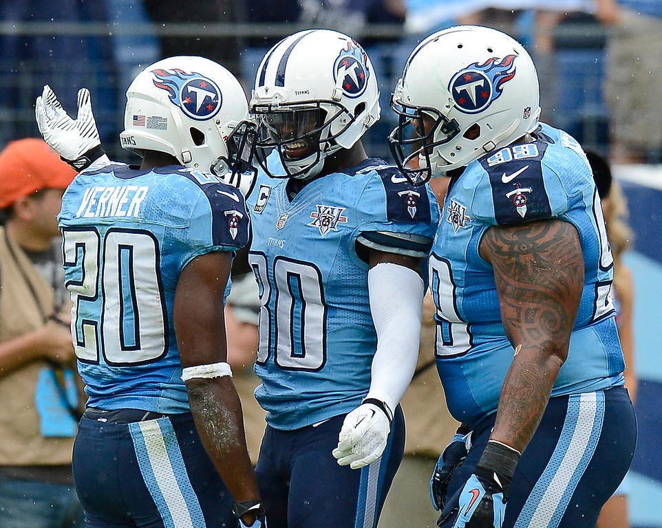 . Tennessee Titans cornerback Alterraun Verner (20) is congratulated by Jason McCourty (30) and Jurrell Casey (99) after Verner recovering a fumble against the New York Jets in the second quarter of an NFL football game on Sunday, Sept. 29, 2013, in Nashville, Tenn. (AP Photo/Mark Zaleski)