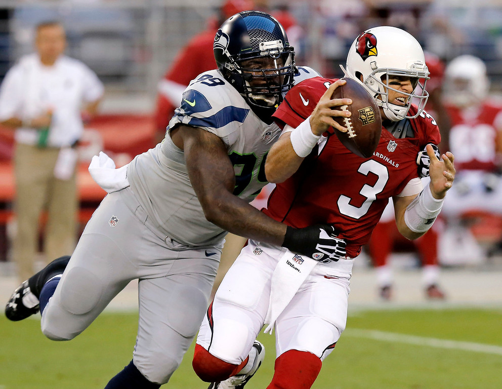 . Arizona Cardinals quarterback Carson Palmer (3) is sacked by Seattle Seahawks defensive tackle Tony McDaniel (99) during the first half of an NFL football game, Thursday, Oct. 17, 2013, in Glendale, Ariz. (AP Photo/Ross D. Franklin)