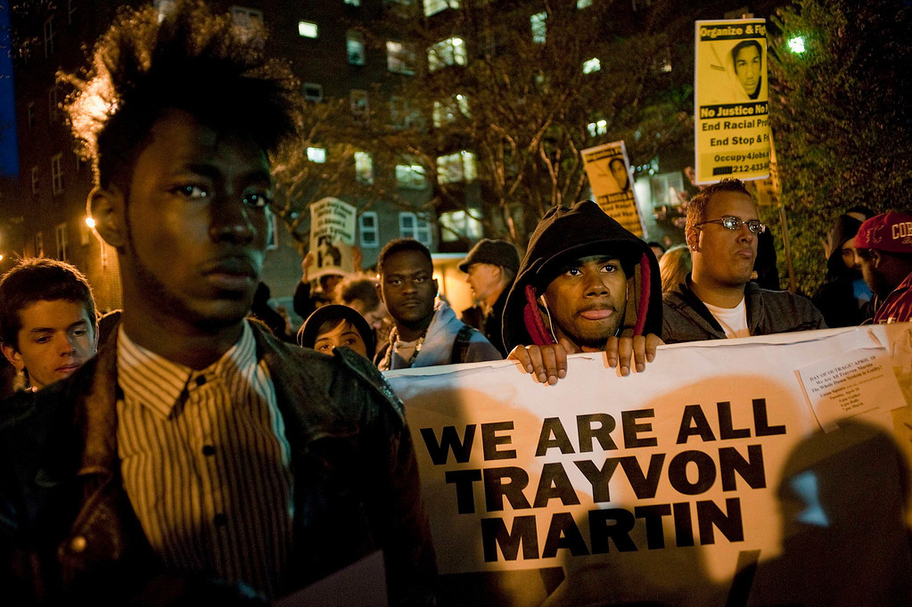 . Demonstrators march in a rally in support of slain teenager Trayvon Martin in New York April 10, 2012. The February 26 killing of the black teenager by neighborhood watch captain George Zimmerman, a Hispanic man, has triggered protests around the country.     REUTERS/Keith Bedford