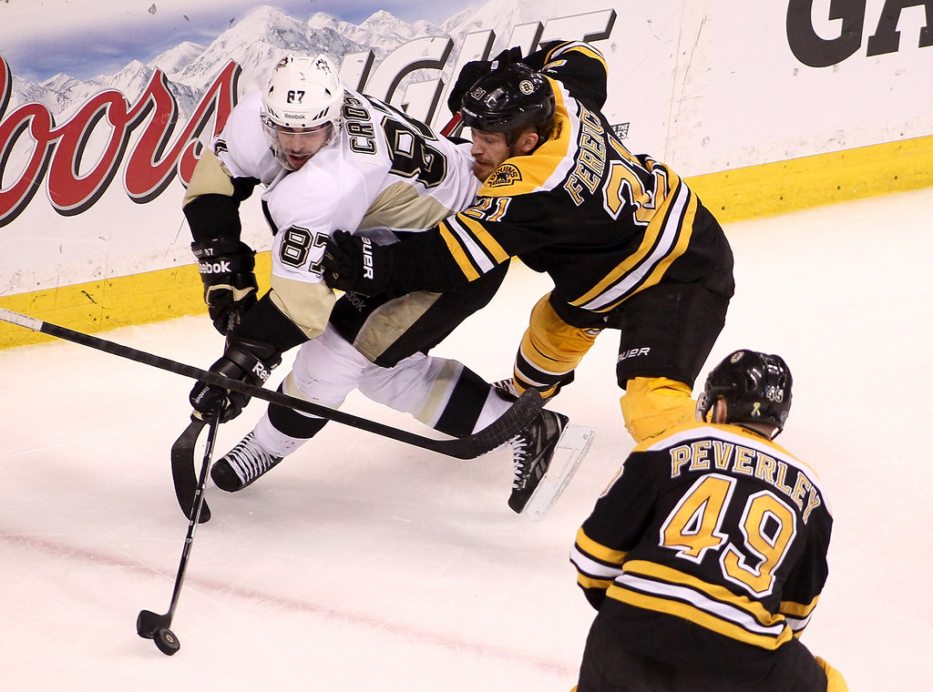. BOSTON, MA - JUNE 07:  Sidney Crosby #87 of the Pittsburgh Penguins handles the puck against Andrew Ference #21 of the Boston Bruins in the third period in Game Four of the Eastern Conference Final during the 2013 Stanley Cup Playoffs at TD Garden on June 7, 2013 in Boston, Massachusetts.  (Photo by Alex Trautwig/Getty Images)