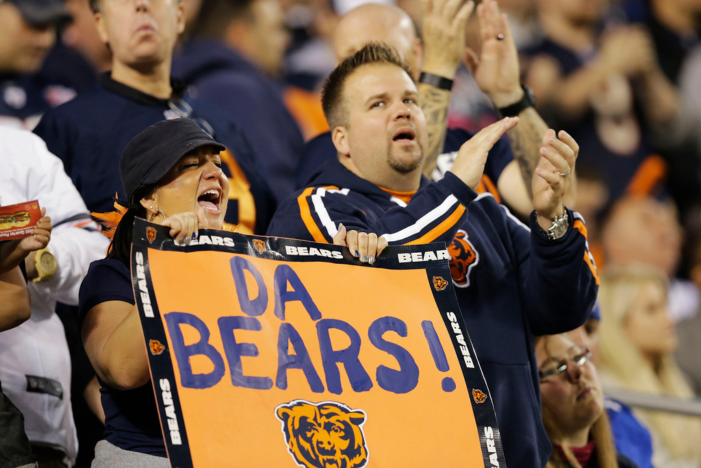 . Chicago Bears fans cheer in the first half of the Bears\' NFL football game against the New York Giants, Thursday, Oct. 10, 2013, in Chicago. (AP Photo/Nam Y. Huh)