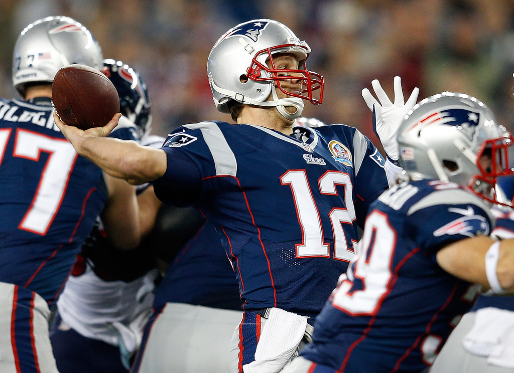 . FOXBORO, MA - DECEMBER 10: Tom Brady #12 of the New England Patriots throws against the Houston Texans in the first half at Gillette Stadium on December 10, 2012 in Foxboro, Massachusetts. (Photo by Jim Rogash/Getty Images)