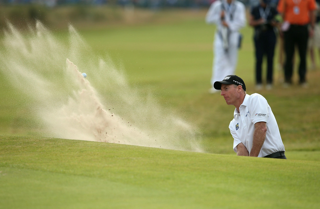 . US golfer Jim Furyk plays from a green-side bunker on the 18th hole during his fourth round 65, on the final day of the 2014 British Open Golf Championship at Royal Liverpool Golf Course in Hoylake, north west England on July 20, 2014.   ANDREW YATES/AFP/Getty Images
