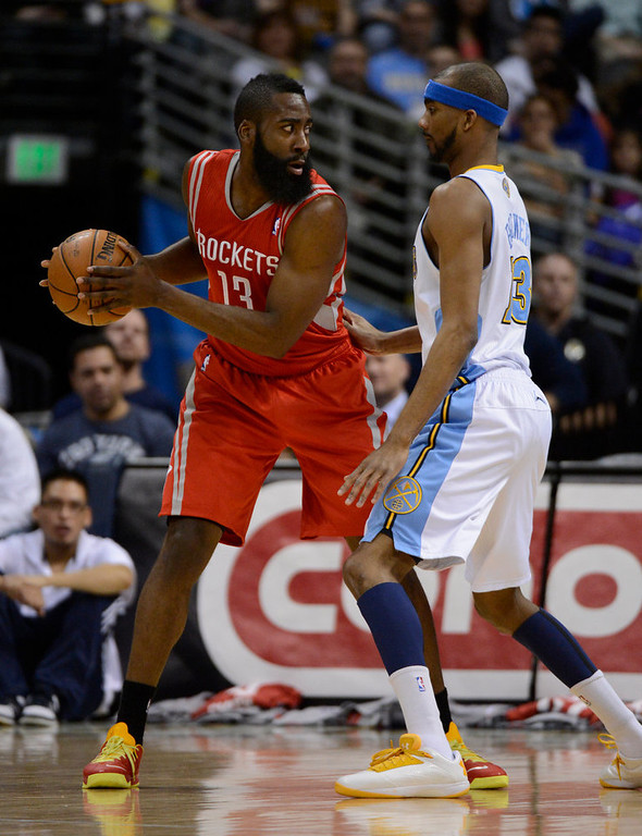 . DENVER, CO. - JANUARY 30: Houston Rockets shooting guard James Harden (13) is guarded by Denver Nuggets small forward Corey Brewer (13) during the first quarter January 30, 2013 at Pepsi Center. The Denver Nuggets take on the Houston Rockets in NBA action. (Photo By John Leyba/The Denver Post)