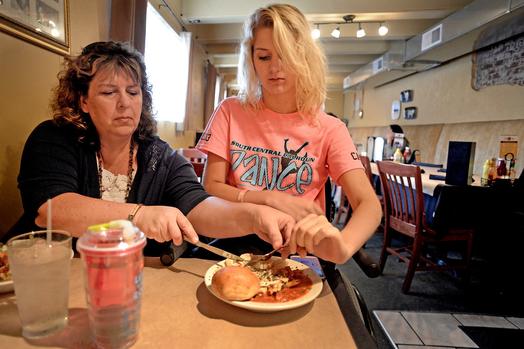 . The neck injury also affected Mackenzie�s use of her arms and fingers, which remained stiff more than a year after her accident. Eating is slow, and she�s lost some appetite -- she thinks she�s lost 20 pounds. �A lot of people don�t realize I don�t have any finger movement. I�m a good faker.� (Photo By Craig F. Walker / The Denver Post)