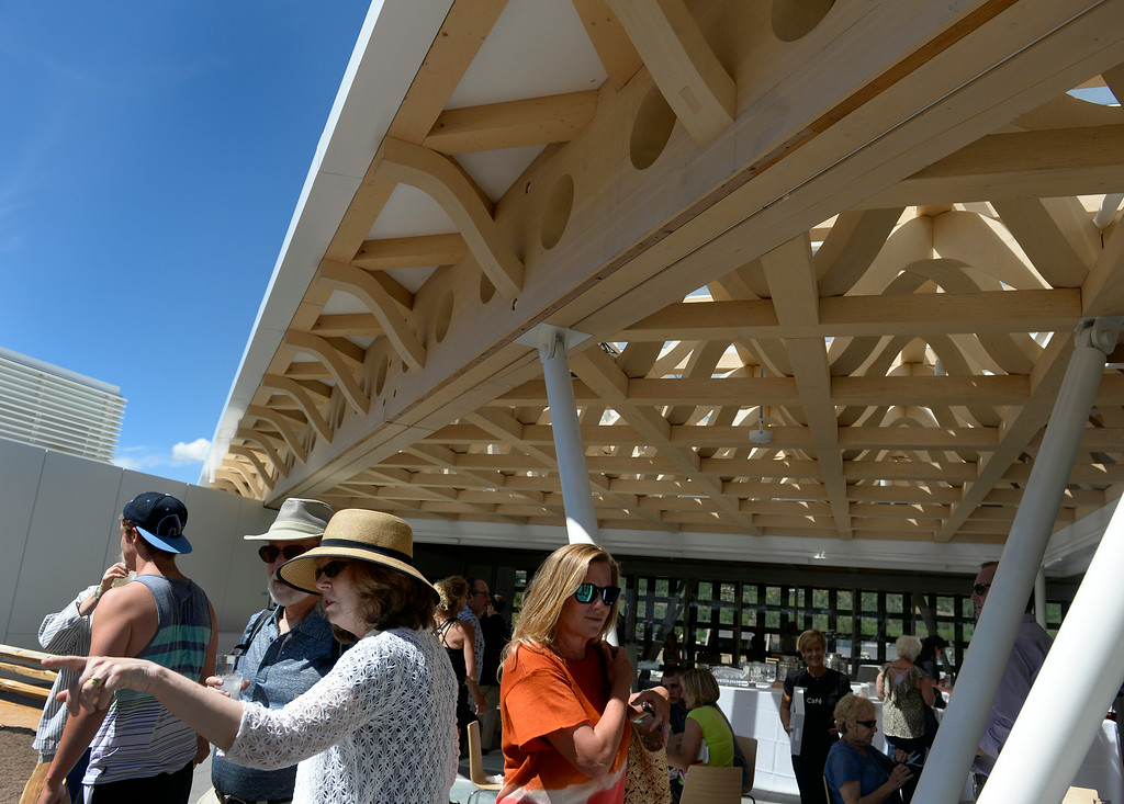 . Visitors view the rooftop patio with the intricately designed ceiling coming in to full view above them. The Aspen Art Museum celebrates its grand opening to the public on Saturday, Aug. 2, 2014. The architect on the project, Shigeru Ban, was there for the celebration which included an official ribbon cutting and fireworks. (Photo by Kathryn Scott Osler/The Denver Post)