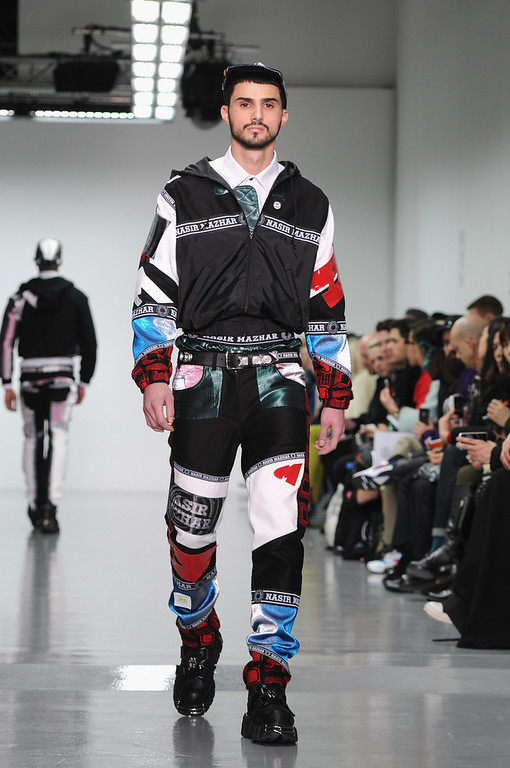 . A model walks the runway at the Nasir Mazhar show during The London Collections: Men Autumn/Winter 2014 on January 8, 2014 in London, England.  (Photo by Eamonn M. McCormack/Getty Images)