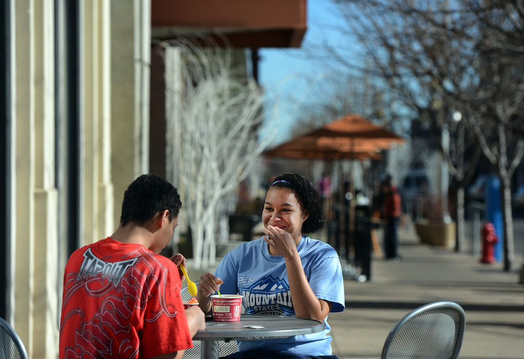 . Brian Bond and his sister Briana share a laugh outside Zinga Frozen Yogurt  at Belmar in Lakewood, CO, January 22, 2013. (Photo By Craig F. Walker / The Denver Post)