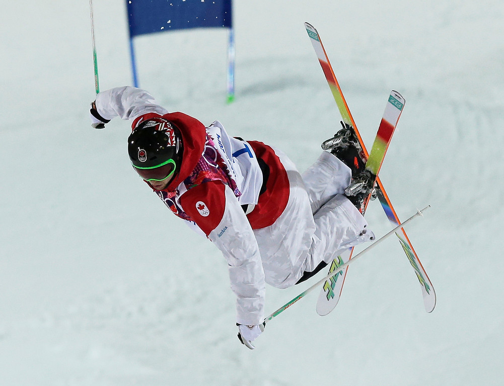 . Canada\'s Alex Bilodeau competes in the men\'s moguls finals at the Rosa Khutor Extreme Park at the 2014 Winter Olympics, Monday, Feb. 10, 2014, in Krasnaya Polyana, Russia. (AP Photo/Andy Wong)