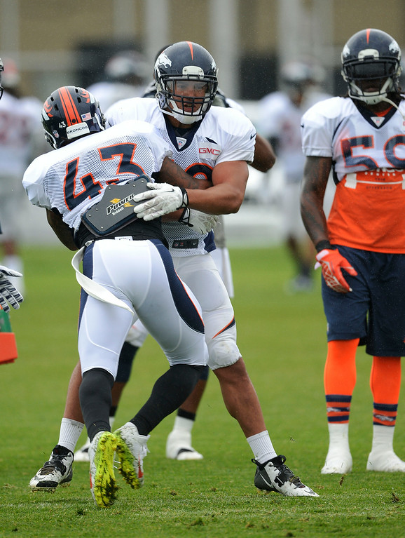 . Denver Broncos strong safety T.J. Ward (43) and Denver Broncos linebacker L.J. Fort (50) run through drills on day seven of the Denver Broncos 2014 training camp July 31, 2014 at Dove Valley. (Photo by John Leyba/The Denver Post)