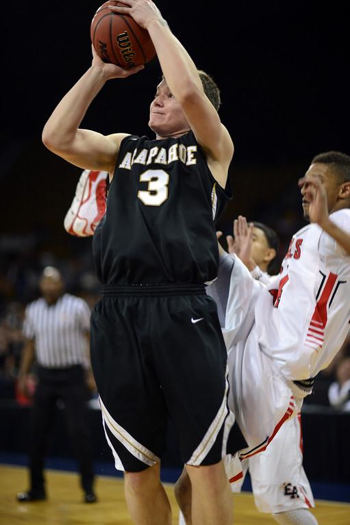 . DENVER, CO. - MARCH 08: Ethan Brunhofer #3 of Arapahoe High School is aiming basket during 5A boys quarter final game against East High School at Denver Coliseum. March 8, 2013. Denver, Colorado. (Photo By Hyoung Chang/The Denver Post)