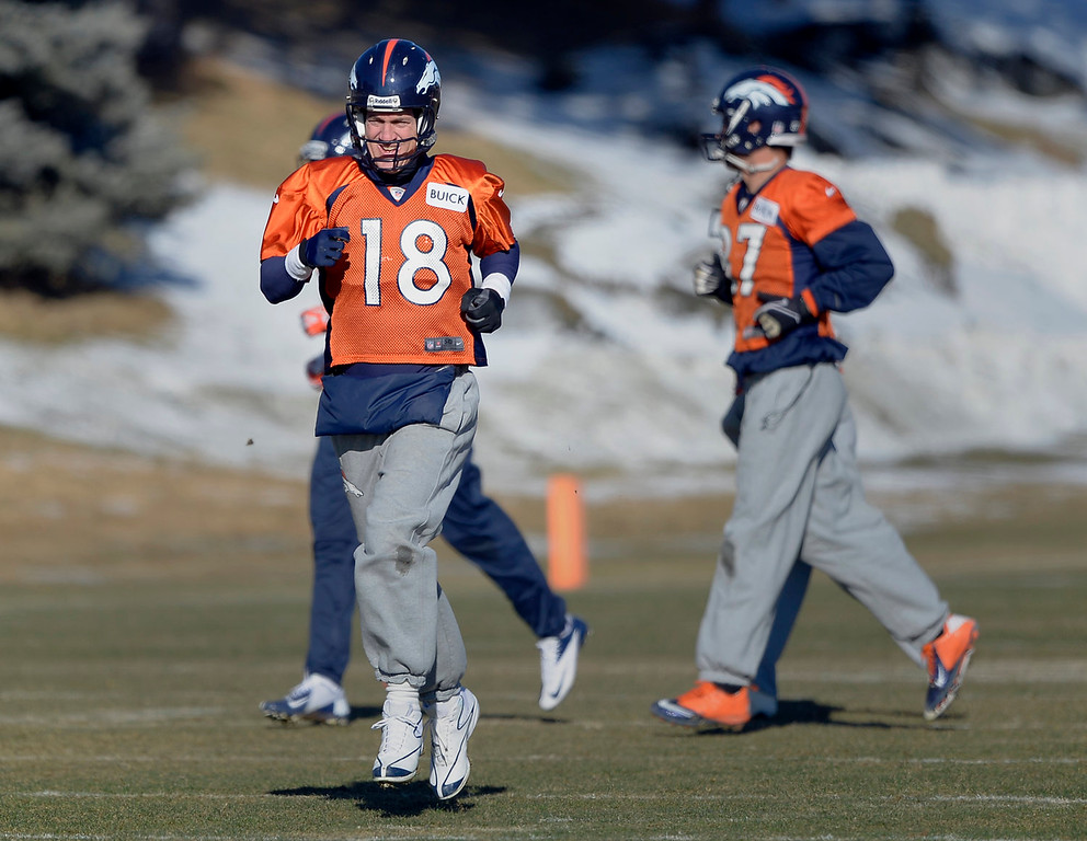 . Denver Broncos quarterback Peyton Manning (18) heads to drills during practice January 2, 2014 at Dove Valley (Photo by John Leyba/The Denver Post)