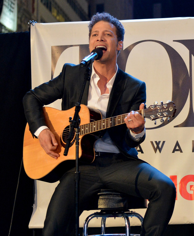 . Host Justin Guarini performs onstage during the 68th Annual Tony Awards Times Square Simulcast at Times Square on June 8, 2014 in New York City.  (Photo by Slaven Vlasic/Getty Images for Tony Awards Productions)