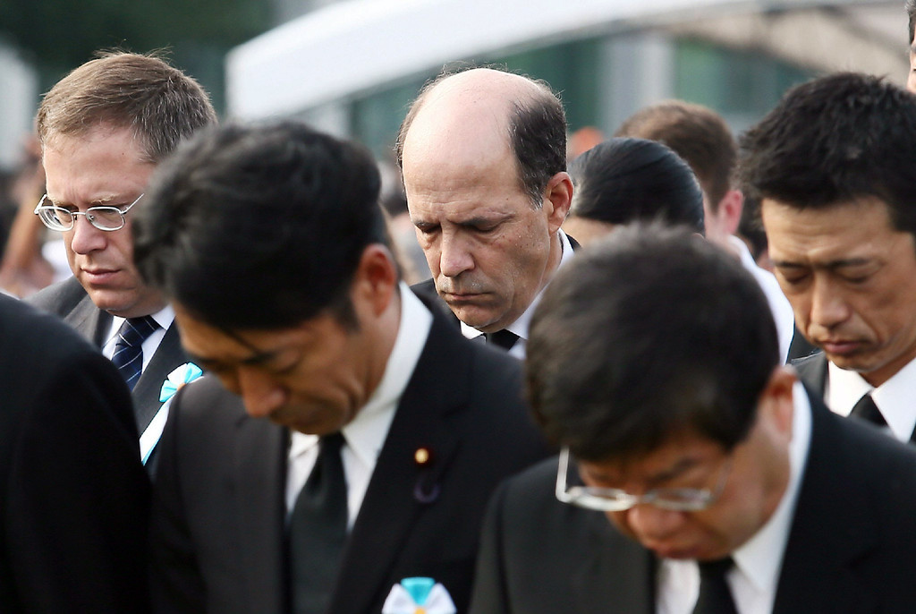 . US Ambassador to Japan John Roos (C) prays in silence at a memorial service for A-bomb victims at the Peace Memorial Park in Hiroshima, western Japan on August 6, 2013 as ceremonies are held to mark the 68th anniversary of the bombing.        AFP PHOTO / JIJI PRESS    /AFP/Getty Images
