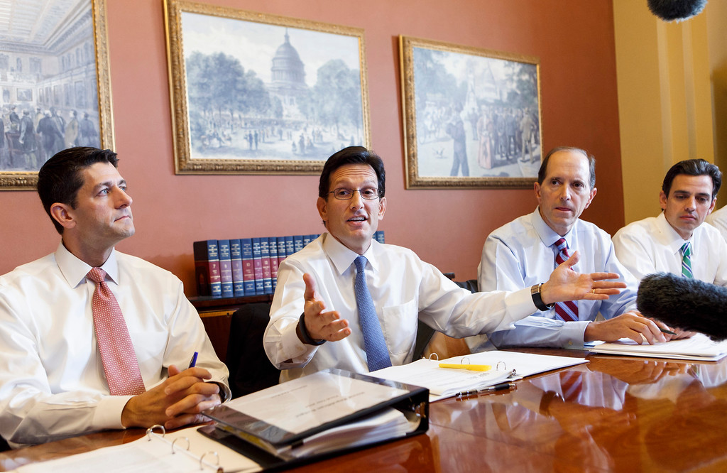 . With the federal government out of money and out of time, House Majority Leader Eric Cantor, R-Va., center, meets with House GOP conferees as the Republican-controlled House and the Democrat-controlled Senate remain at an impasse, neither side backing down over Obamacare, Tuesday, Oct. 1, 2013, on Capitol Hill in Washington. From left are, House Budget Committee Chairman Rep. Paul Ryan, R-Wis., Cantor, House Ways and Means Committee Chairman Rep. Dave Camp , R-Mich., and Rep. Tom Graves, R-Ga. Graves led an effort with other emboldened conservatives that forced Speaker Boehner and the leadership to tie the money needed to keep the government running with defunding Obamacare.  (AP Photo/J. Scott Applewhite)