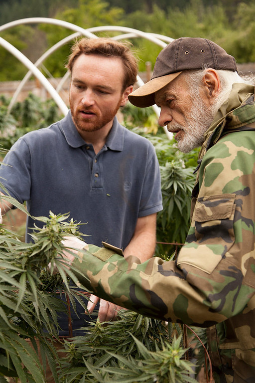 ". BE Smith shows Matt Shotwell his plants in ""Weed Country\"" on Discovery Channel."
