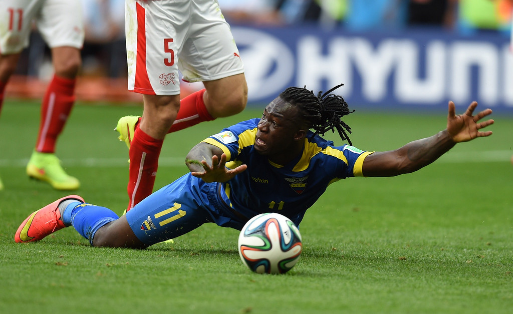 . Ecuador\'s forward Felipe Caicedo falls on the pitch during a Group E football match between Switzerland and Ecuador at the Mane Garrincha National Stadium in Brasilia during the 2014 FIFA World Cup on June 15, 2014.    AFP PHOTO/ PEDRO UGARTE