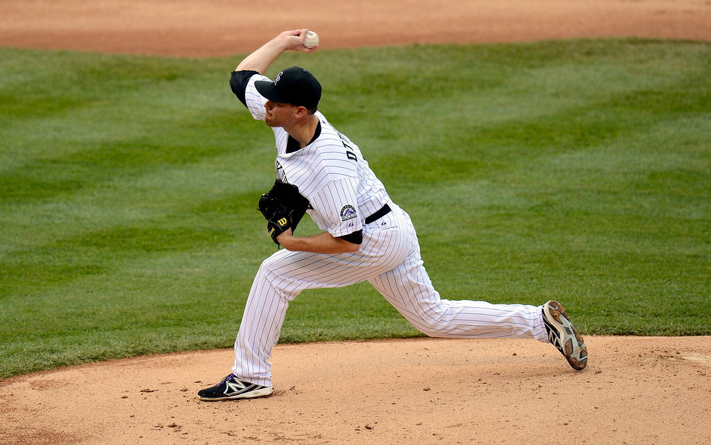 . Adam Ottavino (0) of the Colorado Rockies delivers a pith in the fifth inning against the New York Yankees May 9, 2013 at Coors Field. (Photo By John Leyba/The Denver Post)