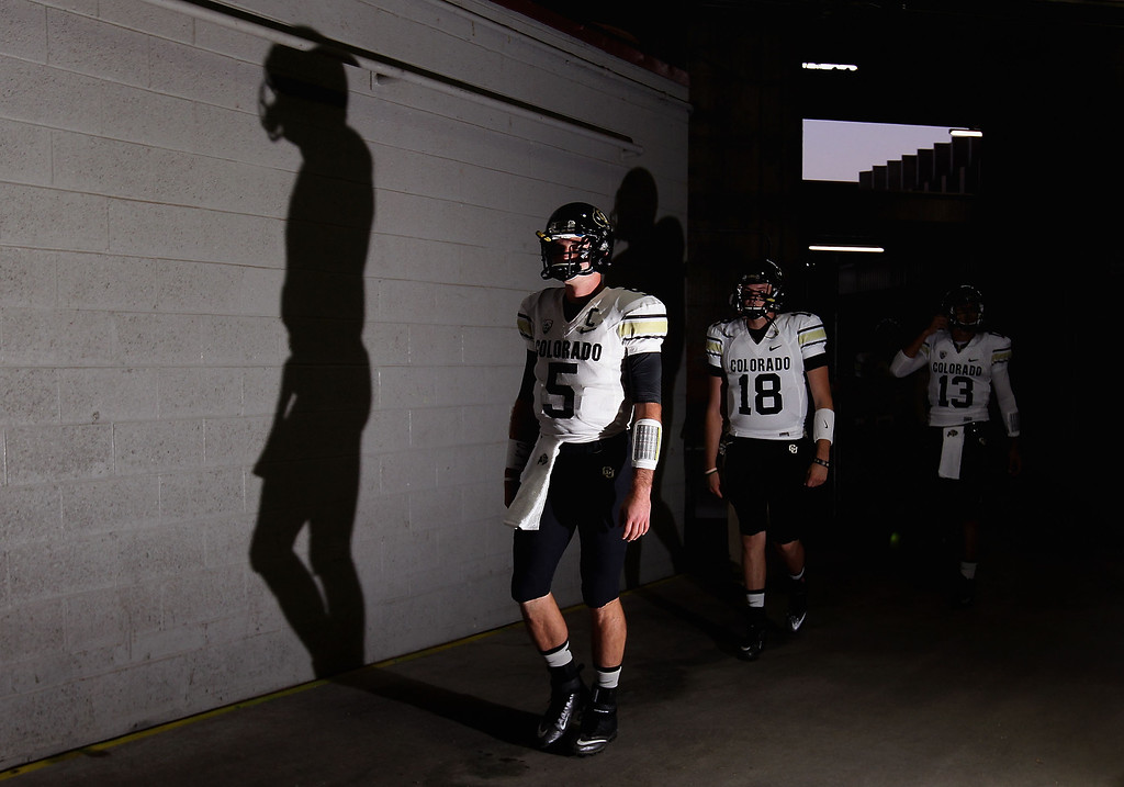 . TEMPE, AZ - OCTOBER 12:  Quarterbacks Connor Wood #5 and Stevie Joe Dorman #18 of the Colorado Buffaloes walk out onto the field before the college football game against the Arizona State Sun Devils at Sun Devil Stadium on October 12, 2013 in Tempe, Arizona.  (Photo by Christian Petersen/Getty Images)