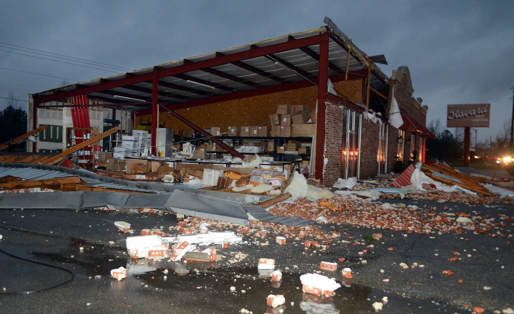. A business at 5133 Lincoln Road Extension in Hattiesburg, Miss., is damaged after an apparent tornado Sunday, Feb. 10, 2013. Major damage was reported in Hattiesburg and Petal, including on the campus of the University of Southern Mississippi. (AP Photo/Chuck Cook)