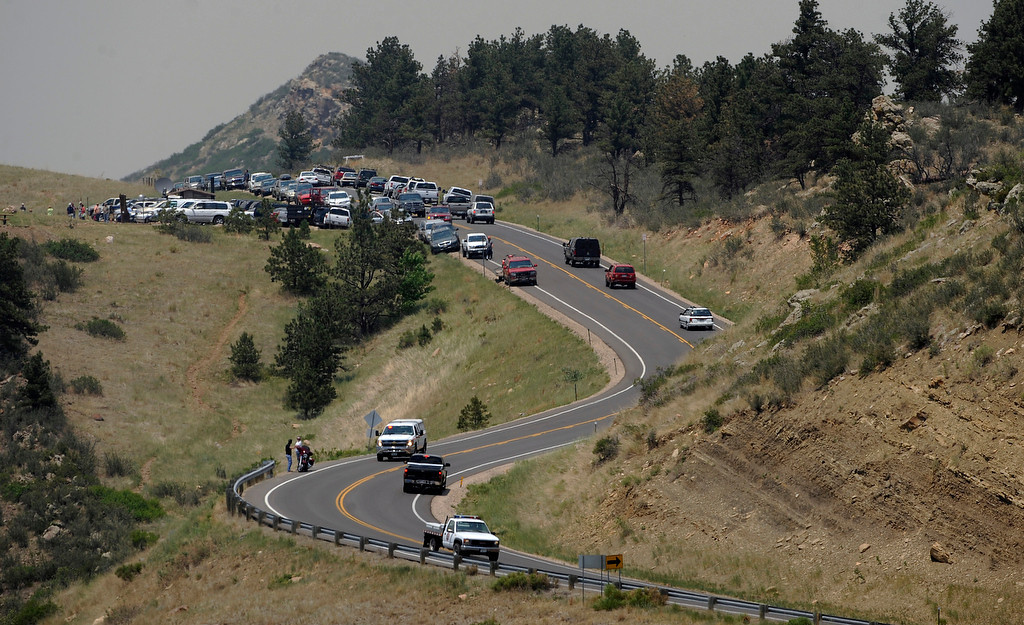 . Hundreds of people and cars lined County Road 23 to watch the fire which is directly across Horsetooth Reservoir. Between County Road 23 and Horsetooth reservoir seemed to be the place for homeowners and the public who wanted to view the fire.  Directly across the reservoir homeowners could see their homes and the firefight trying to save them. Soldier Canyon and Mill Creek estates can be seen directly across the water.  A helicopter was being used to pull water out of Horsetooth Reservoir to drop directly on smoke and flames  around the houses. The High Park fire northwest of Fort Collins continues to burn today June 11th, 2012.  The fire is now estimated at over 40,000 acres and still zero percent containment. Helen H. Richardson, The Denver Post