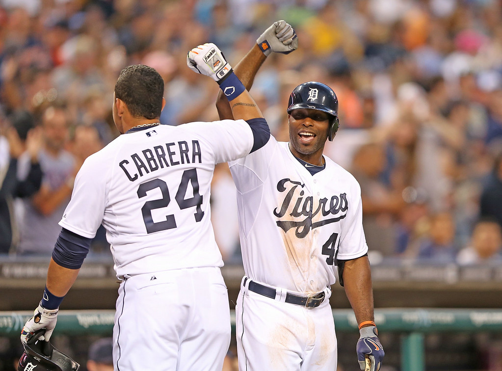 . DETROIT, MI - AUGUST 02: Miguel Cabrera #24 of the Detroit Tigers celebrates after hitting a solo home run to center field with teammate Torii Hunter #48 during the third inning of the game against the Colorado Rockies at Comerica Park on August 2, 2014 in Detroit, Michigan.  (Photo by Leon Halip/Getty Images)