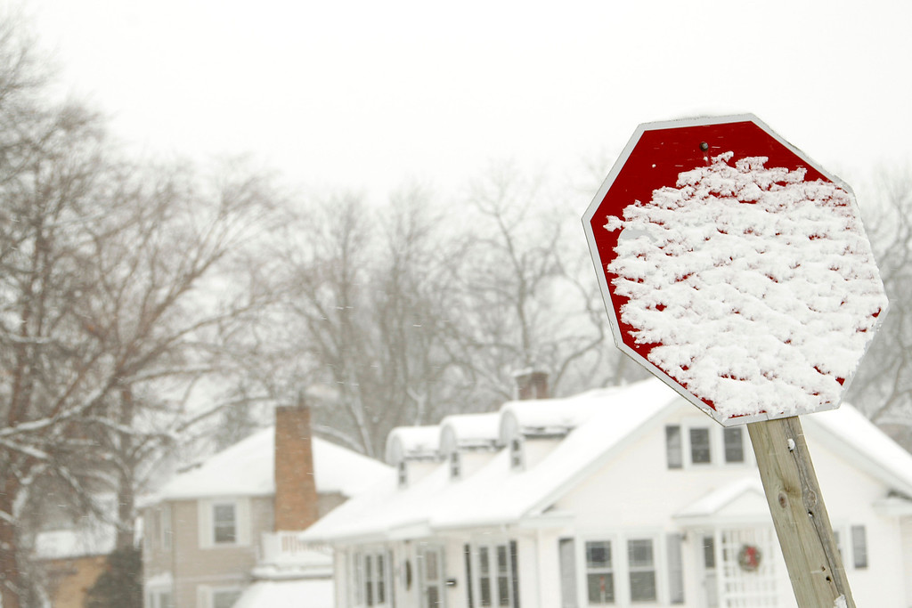 . Snow is caked on a stop sign on Fletcher Avenue in Waterloo, Iowa, December 20, 2012. The first major winter storm of the year took aim at the U.S. Midwest on Thursday, triggering high wind and blizzard warnings across a widespread area, and a threat of tornadoes in Gulf Coast states to the south. REUTERS/Matthew Putney/The Waterloo Courier/Handout