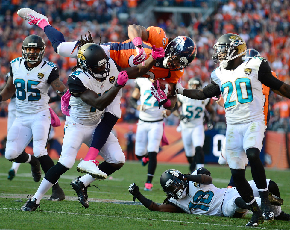 . Denver Broncos strong safety David Bruton (30) gets hit after the Broncos faked a punt in the third quarter. The Denver Broncos took on the Jacksonville Jaguars at Sports Authority Field at Mile High in Denver on October 13, 2013. (Photo by AAron Ontiveroz/The Denver Post)
