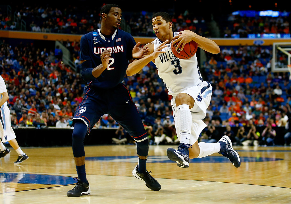 . BUFFALO, NY - MARCH 22:  Josh Hart #3 of the Villanova Wildcats drives to the basket as DeAndre Daniels #2 of the Connecticut Huskies defends during the third round of the 2014 NCAA Men\'s Basketball Tournament at the First Niagara Center on March 22, 2014 in Buffalo, New York.  (Photo by Jared Wickerham/Getty Images)
