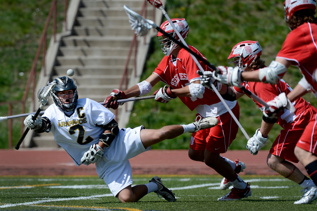. LITTLETON, CO. - MAY 04: Arapahoe\'s Mike Babb makes a pass against Regis defenders during the varsity high school lacrosse game between the Arapahoe Warriors and the Regis Jesuit Raiders in Littleton, CO May 04, 2013. The Raiders won the game 9-6. (Photo By Craig F. Walker/The Denver Post)