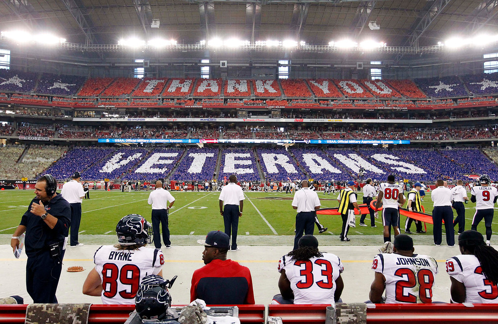 . Fans hold flip cards from their seats thanking veterans during the first half of an NFL football game between the Houston Texans and the Arizona Cardinals, Sunday, Nov. 10, 2013, in Glendale, Ariz. The NFL is celebrating Veterans Day with a league wide ìSalute to Serviceî campaign. (AP Photo/Ross D. Franklin)