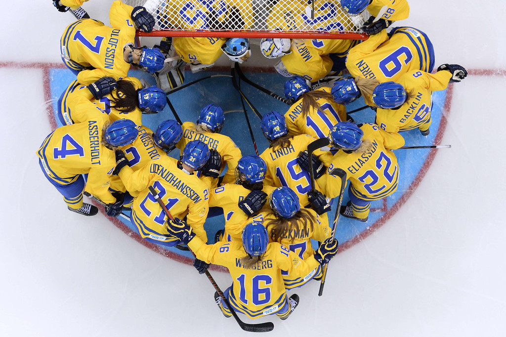 . Sweden\'s players gather before the start of the Women\'s Ice Hockey Group B match Sweden vs Japan at the Shayba Arena during the Sochi Winter Olympics on February 9, 2014. ANDREJ ISAKOVIC/AFP/Getty Images