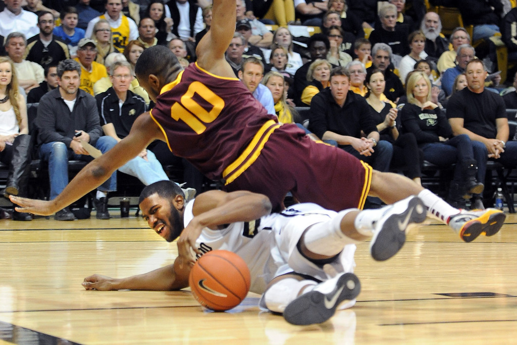 . Arizona State\'s Evan Gordan (10) falls on Colorado\'s Jeremy Adams while going for a loose ball during the first half of an NCAA college basketball game on Saturday, Feb. 16, 2013, in Boulder, Colo. (AP Photo/Daily Camera, Cliff Grassmick)