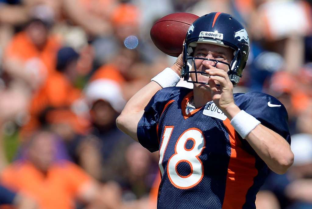 . Denver Broncos QB Peyton Manning (18) throws a pass during training camp August 5, 2013 at Dove Valley. (Photo By John Leyba/The Denver Post)