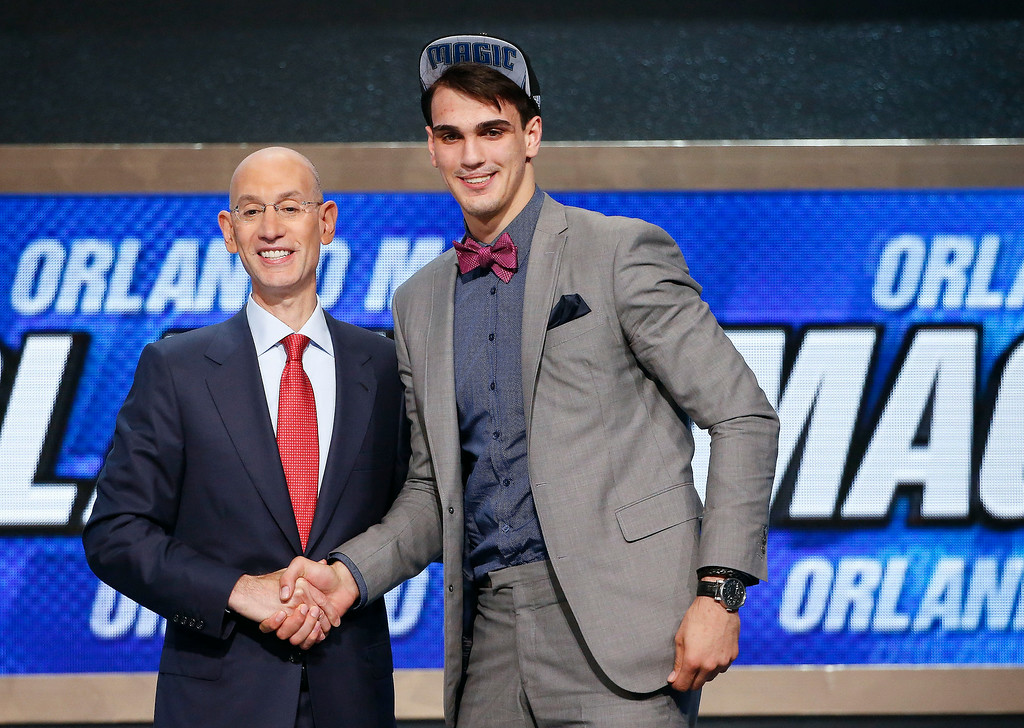 . Dario Saric of Croatia, right, poses for a photo with NBA Commissioner Adam Silver after being selected 12th overall by the Orlando Magic during the NBA basketball draft, Thursday, June 26, 2014, in New York.  Saric was then traded to the Philadelphis 76ers. (AP Photo/Jason DeCrow)