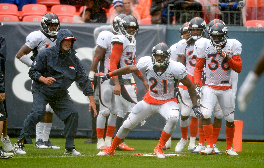 . Denver Broncos cornerback Aqib Talib (21) runs through drills during a rain day on day six of the Denver Broncos 2014 training camp July 30, 2014 at Sports Authority Field at Mile High Stadium.  (Photo by John Leyba/The Denver Post)