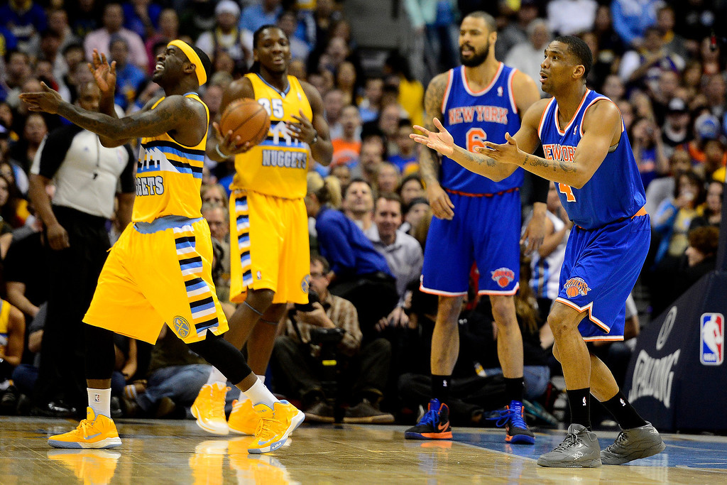 . DENVER, CO - MARCH 13: James White (4) of the New York Knicks reacts to getting called for a foul on Ty Lawson (3) of the Denver Nuggets during the first half of action. The Denver Nuggets play the New York Knicks at the Pepsi Center. (Photo by AAron Ontiveroz/The Denver Post)