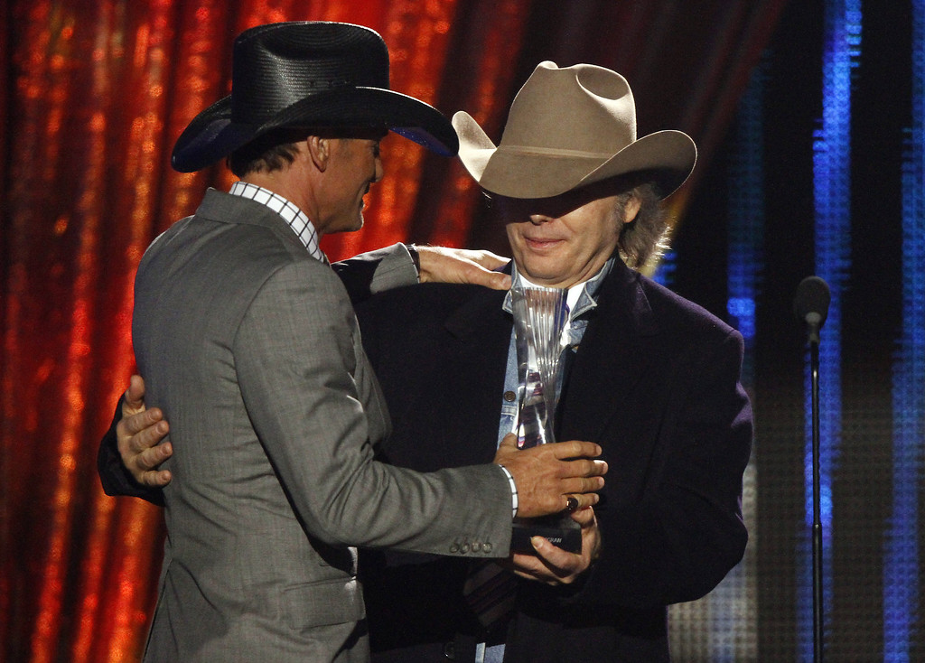 """. Tim McGraw, left, accepts his award from Dwight Yokam at CMT \""""Artists of the Year\"""" show held at the Music City Center on Tuesday, Dec. 3, 2013, in Nashville, Tenn. (Photo by Wade Payne/Invision/AP)"""
