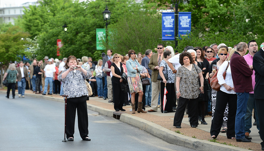 . Fans wait to enter the Grand Ole Opry House for the funeral of country music star George Jones on Thursday, May 2, 2013, in Nashville, Tenn. J (AP Photo/Mark Zaleski)