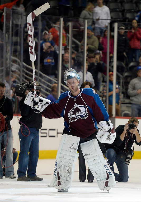 . Colorado Avalanche goalie Semyon Varlamov (1) acknowledges the crowd after being named the number one star of the game against the Chicago Blackhawks November 19, 2013 at Pepsi Center. Colorado Avalanche defeated the Chicago Blackhawks 5-1. (Photo by John Leyba/The Denver Post)