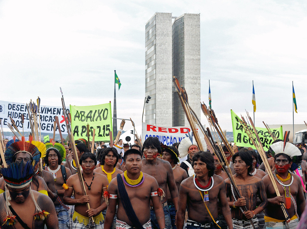 . Indigenous people march in front of the Congress building in Brasilia on October 1, 2013, in the beginning of the National Indigenous Mobilization Week. I AFP PHOTO / Evaristo SA/AFP/Getty Images